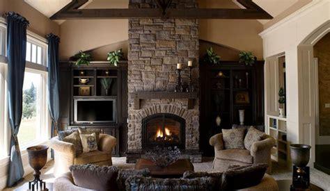 stone fireplace surround using white wooden shelf among