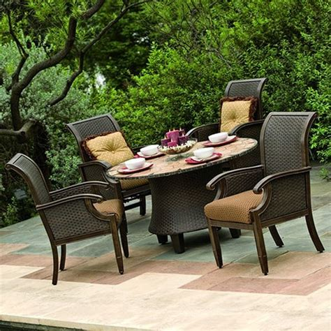 wicker and aluminum outdoor dining table and chair set