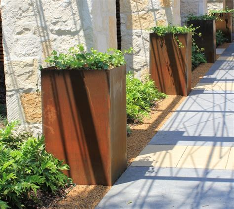 rusted steel planters 7 metal planters award winning contemporary concrete planters and sculpture by adam christopher