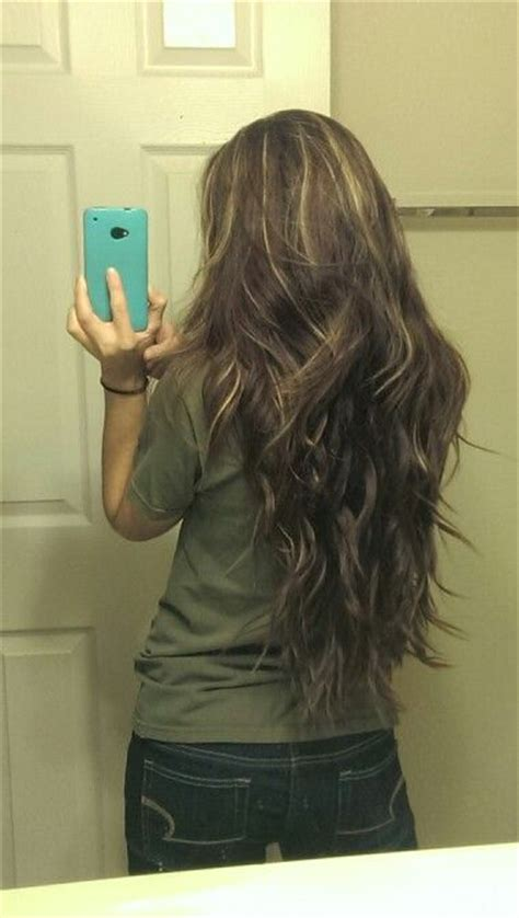 long brown brunette blond highlights hair curly wavy