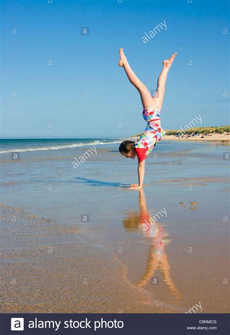 girl  handstand  beach stock photo royalty