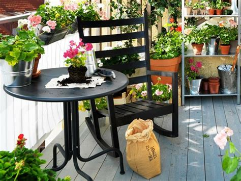 small outdoor furniture balcony with flower decoration