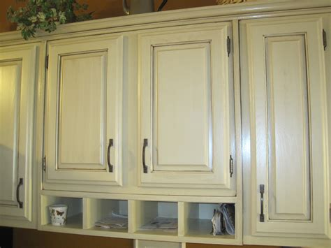 painting oak kitchen cabinets antique white painting and refinishing wall mounted oak kitchen cabinet 9065