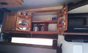 Smart rv cookware storage idea for behind cabinet doors for Truck camper interior ideas