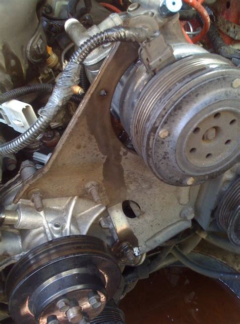 help with ac and power steering bracket ford