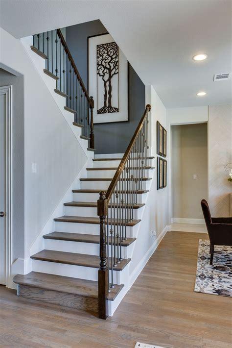 gehan homes stairway light rustic hardwood tread white risers  shaped staircase gehan