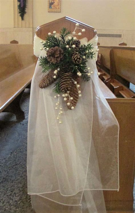 pew swag with ivory organza pine cones pine greens and