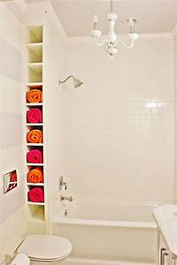 10 ways to creatively add storage to your bathroom for Storing towels in the bathroom