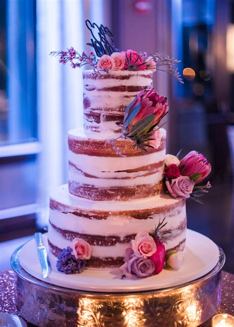 naked wedding cake  pink flowers