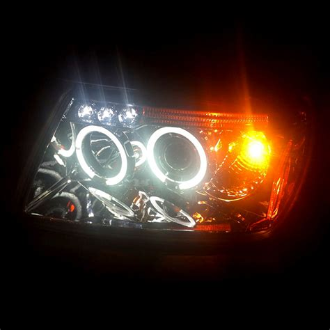 jeep headlights at night 99 04 jeep grand cherokee angel eye halo led projector