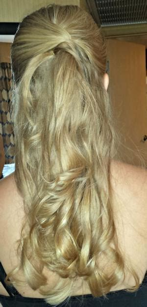 half up half down hairstyle for a wedding or bridesmaids curly pinned back hairdo i