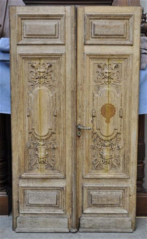 carved oak wood double door  grotesque decor doors