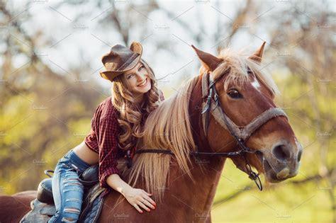 beautiful smiling girl riding horse  autumn field high