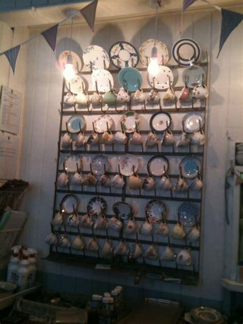 love  massive plate display rack stacked  beautiful vintage tea cups  plates tea