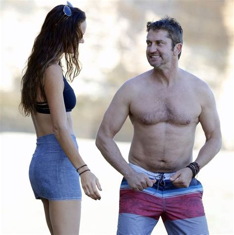 Gerard Butler Lets It All Hang Out As He Cosies Up To