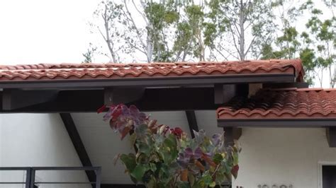 seamless box style gutters  tile roof home  santa ana
