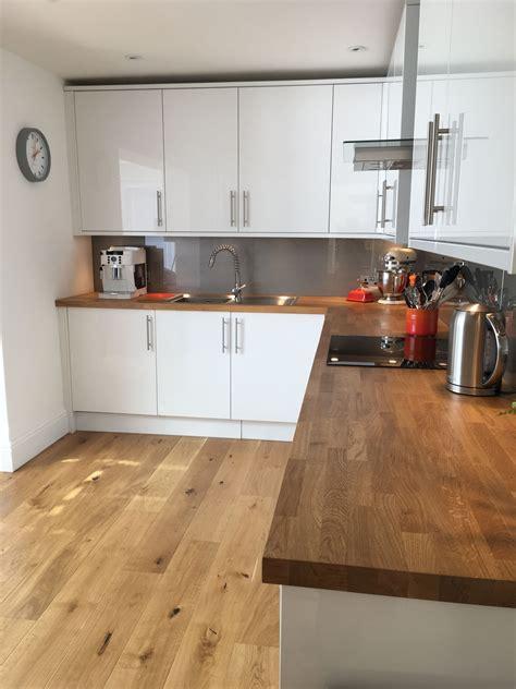 white gloss kitchen  oak worktops kitchen ideas