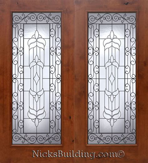 knotty alder wood patio doors with wrought iron