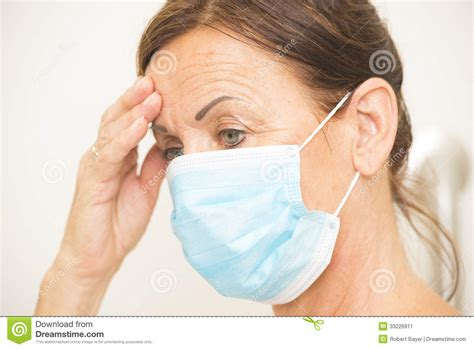 Exhausted Medical Nurse With Mask Over Face Stock Image