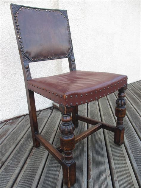 10 carved oak and leather studded dining chairs antiques