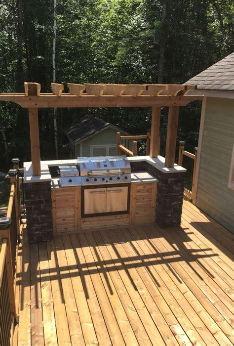 outdoor bbq island built   parents deck  muskoka
