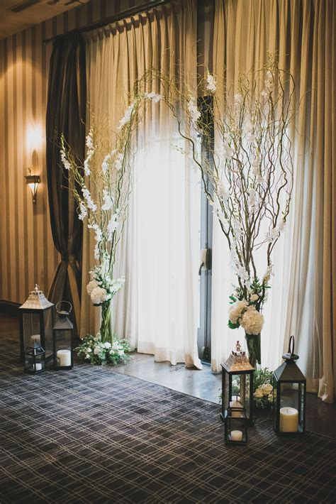 willow branch orchid hydrangea and lantern altar
