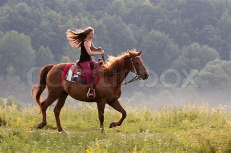 young girl  long hair riding stock photo colourbox
