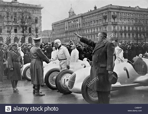 driver signs where to buy adolf and rudolf caracciola in berlin 1937 stock