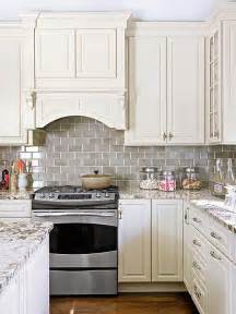 Kitchen Subway Tile Backsplashes Smoke Gray Glass Subway Tile Backsplash White Shaker Cabinets Neutral Quartz Countertop