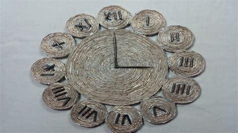 como hacer un reloj con papel periodico youtube
