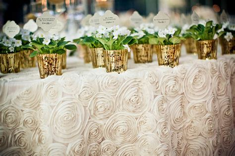 wedding table cloth runners ivory rosette wedding tablecloth with potted gold favors