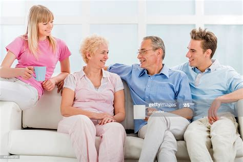 His parents, thomas (chubby) & anne encouraged and supported his vision to help enhance the market with new outdoor seating, extending store hours and inviting everyone. Happy Family Drinking Coffee And Communicating At Home High-Res Stock Photo - Getty Images