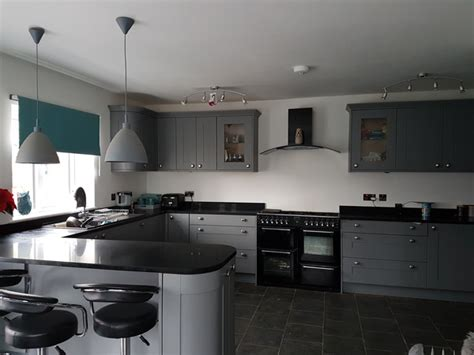 White Cupboards, Black Surface Or Grey