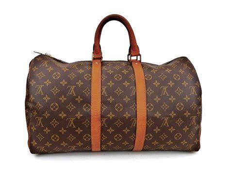 louis vuitton keepall duffle  brown monogram canvas leather weekendtravel bag tradesy