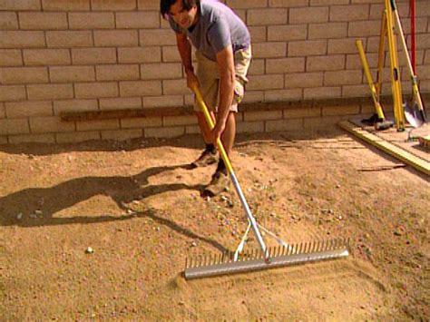laying pavers for a backyard patio hgtv