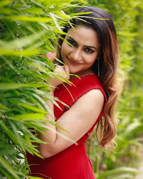 Actress and Singer Rimi Tomy Photos - Indianrays.com