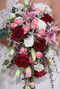 traditional cascade bridal bouquet of pink roses, pink ...
