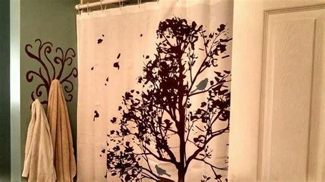 bird shower curtain and painted tree towel holder bird