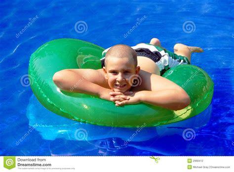 Child Floating On A Inner Tube Stock Photo