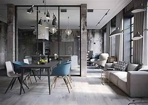 Una cocina abierta al salón de aire industrial · An
