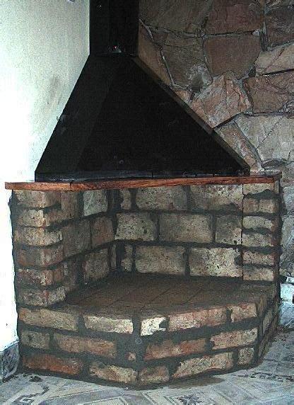estufa lena campana metal  ladrillos instalada