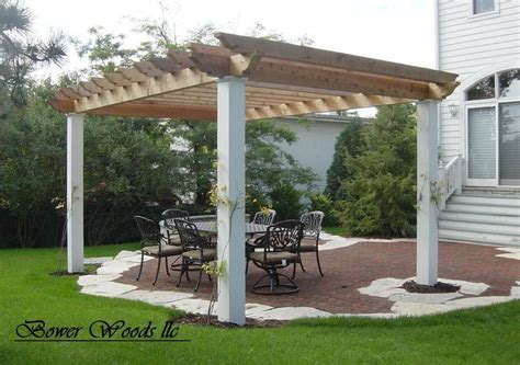 insider free standing pergola on concrete patio garden