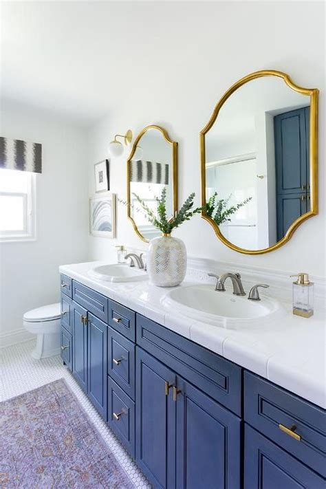 gold mirrors   blue wooden dual washstand