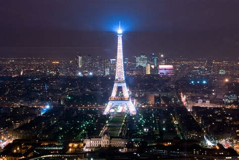 eiffel tower lit  montparnasse tower  drab