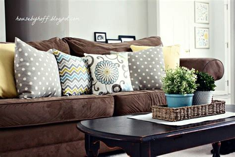 Brown Sofa W/ Pillows In Colors