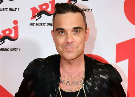 Robbie Williams Testi Robbie Williams Cancels Concerts Following Worrying Test