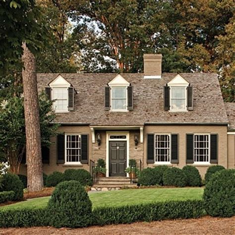 welcoming paint colors welcoming exterior paint dormer windows black shutters and lush landscaping robyn porter