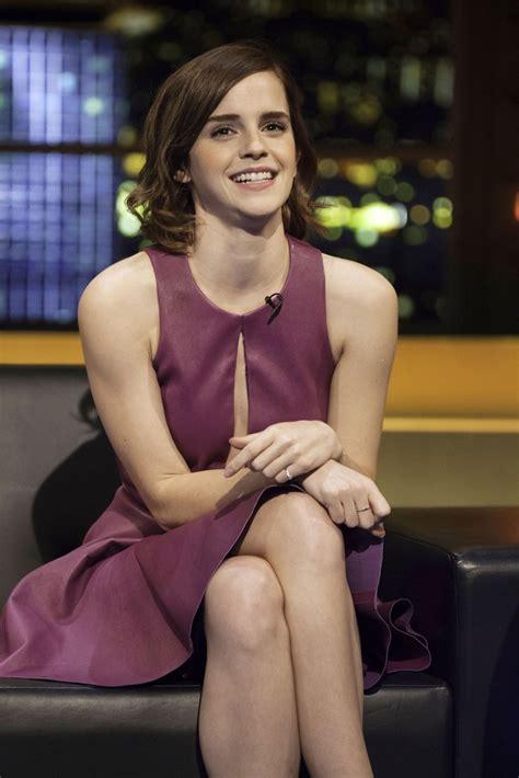 emma watson shows  legs   purple dress