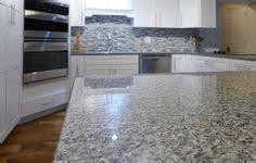 is hardwood flooring for kitchens black slate backsplash tile new caledonia granite 9016