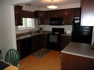 Cherry Cabinets Pergo Floor Black Appliances New Kitchen ...